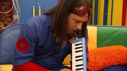 S3e24 Scott playing instrument