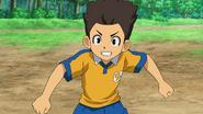 Tasuke in his Raimon uniform
