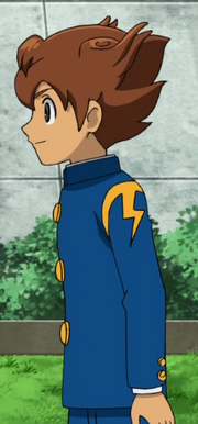 Tenma in his school uniform
