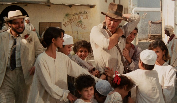 Image result for indiana jones raiders of the lost ark scene when surrounded by the children