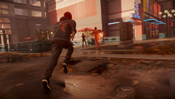 Delsin biegnie za Hankiem po Seattle (inFamous Second Son)