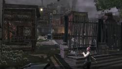 Cole dociera do slumsów Ludzi Ziemi (inFamous)