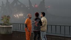 Hank, Delsin i Reggie przed betonową wyspą DOZ (inFamous Second Son)