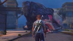 Cole stoi przed zwłokami Behemota (inFamous 2)