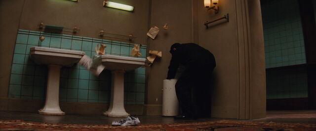 File:Omar searches through trash.jpg