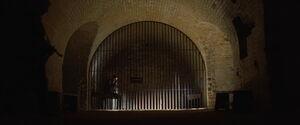 Hugo Stiglitz sitting in a jail