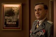 Christoph Waltz as Hans Landa in the cinema lobby