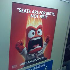 An ad for <i>Inside Out</i> featuring Anger seen on a BART train during the film's first week of release.