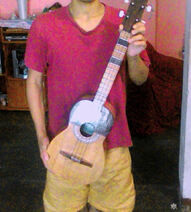 The modern folk lead instrumentalist JohnThvhk and his great venezolan cuatro of the folk-blues and the aggressive musici