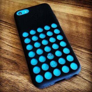 A blue iPhone 5C with a black iPhone 5C case