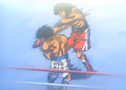 Volg hits Ippo with the White Fang in round two