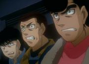 Aoki, Kimura, and Takamura watching Ippo's title match against Sendo
