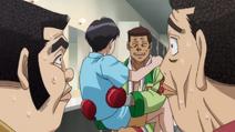 Isamu and Hiroshi reporting to Aoki about Kimura's match against Eleki
