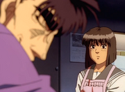 Kumi talking to Ryo before his fight against Ippo