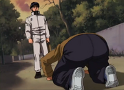 Aoki doing a dogeza in front of Miyata