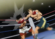 Sanada hitting Ippo with a right hook