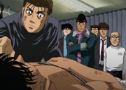 Sanada checking on Ippo after their match