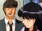 Fujii and Mari discussing Ippo and Sendo's match