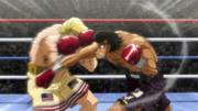 Eagle blocking Takamura's punch