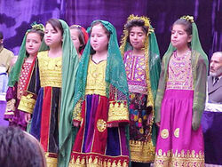 Afghan girls in traditional clothes