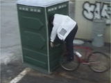 Mountain Bike Into Porta Potty