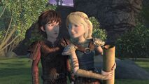 Astrid having come up to Hiccup to show him her design