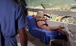 Jill on the balcony (Goldfinger)