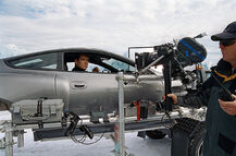Brosnan filming on location in the Aston (Die Another Day)