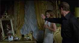 Bond uses Holly's Flame Thrower perfume