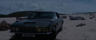 On Her Majesty's Secret Service - Bond pulls up on the beach in his DBS