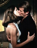 Holly kisses Bond