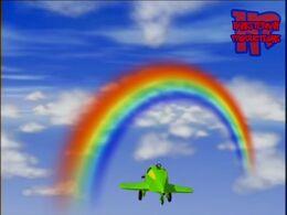 Snuffy flying toward a rainbow CDATA