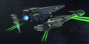 B-Flügler passieren Raider-Klasse-Korvette