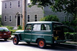 Willys Jeep Wagon green in yard maintenance use