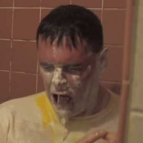 The egg in real life under the shower without most of his makeup and with some egg yolk on his shirt.