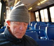Old man on bus sleeping