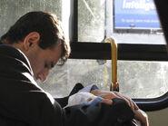 Dad sleeping on bus