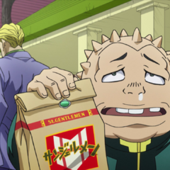 Shigechi holding what he believes is his lunch, which is actually the