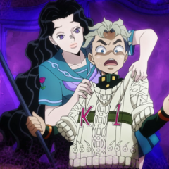 Telling Koichi that her knitted sweater fits him perfectly.