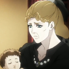 Roughly 51 years old, holding a baby Joseph after her <a href=