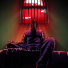 Angelo in a prison cell