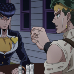 Rohan readies to his dice while Josuke tries to hold back laughter.