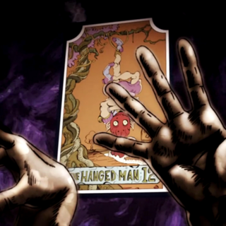 The Hanged Man card with J. Geil's hands
