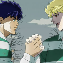 Dio and Jonathan as adults, playing Rugby