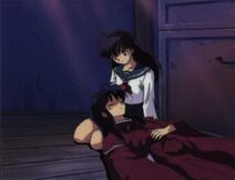JL is laying on Kagome