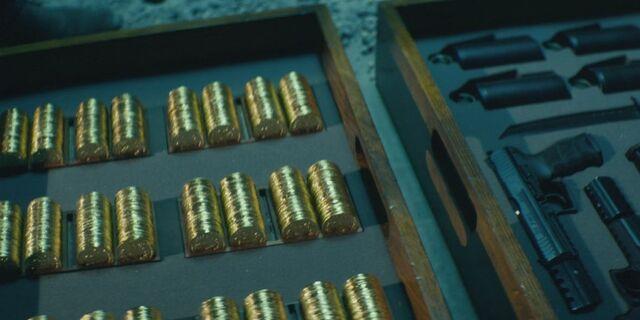 File:John-Wick-Coins-and-Guns.jpg