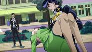 Josuke cradles his mom
