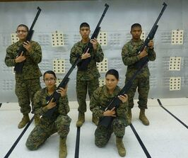 MCJROTC cadets holding air rifles