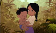 Shanti has Ranjan in her arms and she's very angry at Mowgli