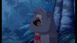 Baloo the Bear and Mowgli hugs